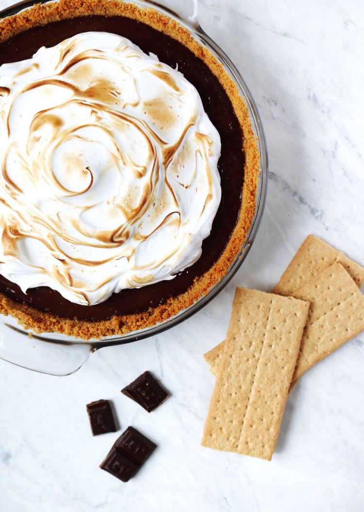 Toasted S'mores Pie recipe with a fluffy marshmallow topping. Perfect for a cozy fall day | Pies Before Guys